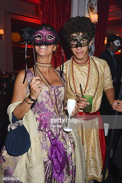 Sandrine Taddei and her son attend the Marc Dorcel 35th Anniversary Masked Ball at the Chalet des Iles on October 10 2014 in Paris France