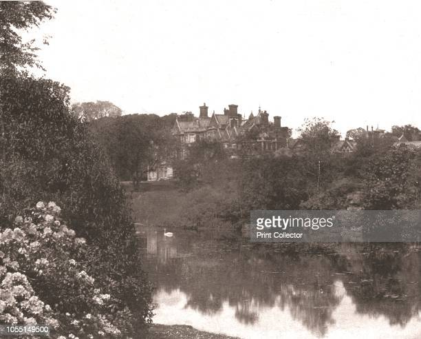 Sandringham House, Norfolk, 1894. View of the royal residence, with ornamental lake in the foreground. From Beautiful Britain; views of our stately...