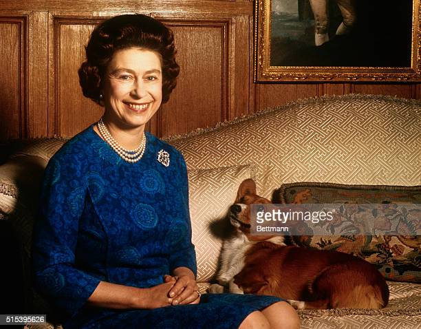 Sandringham Norfolk England UK Britain's Queen Elizabeth II smiles radiantly during a picturetaking session in the salon at Sandringham House Her pet...