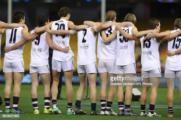 Sandringham players line up during the national anthem prior to the TAC Cup Grand Final match between Geelong and Sandringham at Etihad Stadium on...