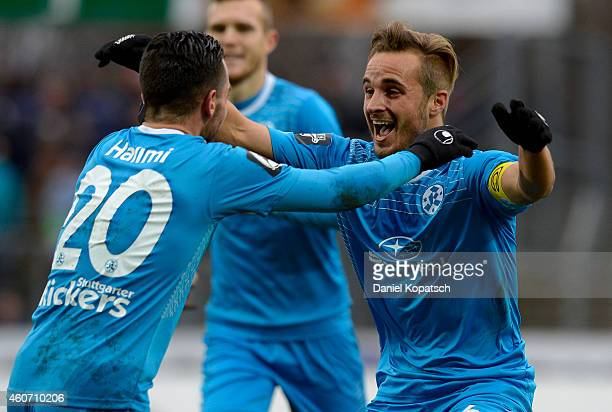 Sandrino Braun of Stuttgart celebrates his team's first goal with team mate Besar Halimi of Stuttgart during the third league match between...