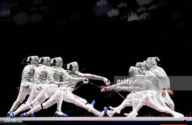Sandro Bazadze of Georgia and Kim Junghwan of Korea compete in the Men's Sabre Individual Bronze Medal Bout on day one of the Tokyo 2020 Olympic...