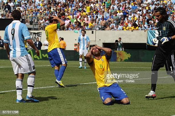 Sandro, Brazil, reacts after putting a header over the bar during the Brazil V Argentina International Football Friendly match at MetLife Stadium,...
