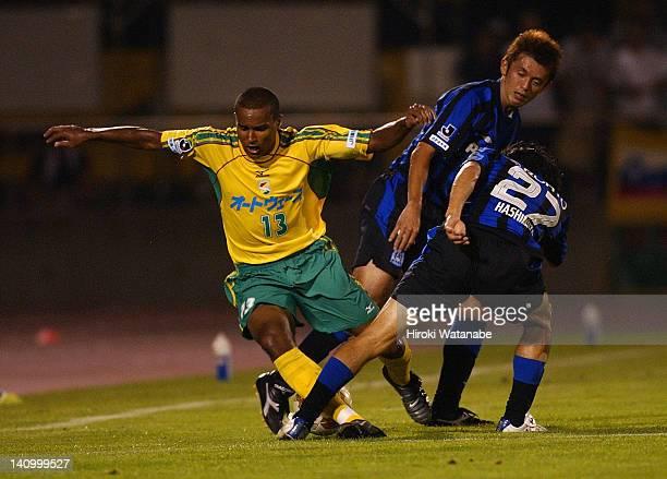 Sandro Cardoso dos Santos of JEF United Ichihara is tackled by Hideo Hashimoto of Gamba Osaka during the JLeague match between JEF United Ichihara...