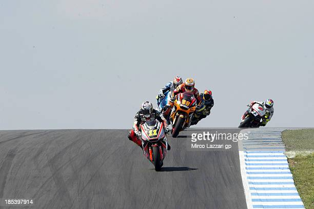 Sandro Cortese of Germany and Dynavolt Intact GP leads the field during the Moto2 race ahead of the Australian MotoGP which is round 16 of the MotoGP...