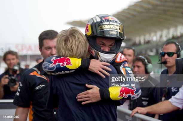 Sandro Cortese of Germany and Red Bull KTM Ajo celebrates with mechanics after winning the Moto3 race, sealing victory in the Moto3 Championship,...