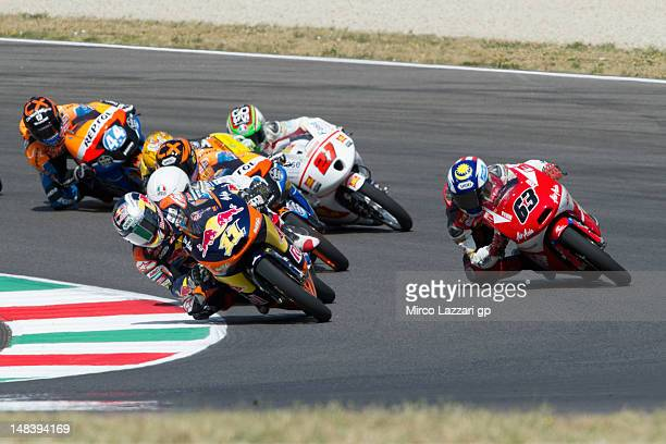 Sandro Cortese of Germany and Red Bull KTM Ajo leads other riders into a corner during the Moto3 race of the MotoGP of Italy at Mugello Circuit on...