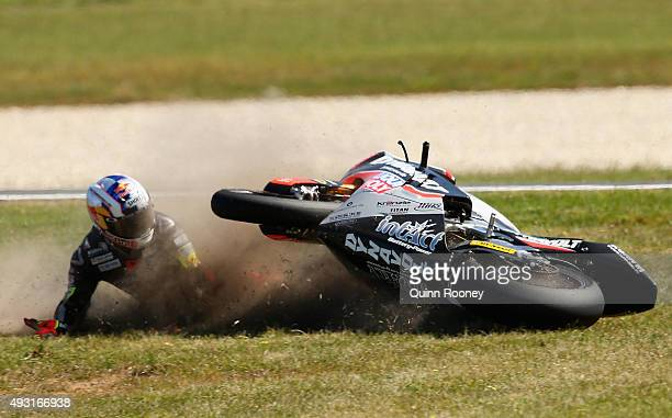 Sandro Cortese of Germany and the Dynavolt Intact GP crashes during the Moto3 Race before the 2015 MotoGP of Australia at Phillip Island Grand Prix...