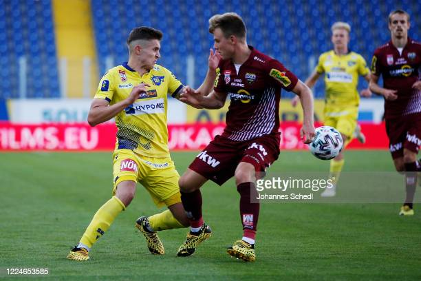 Sandro Ingolitsch of St. Poelten and Lars Nussbaumer of Altach during the tipico Bundesliga match between Spusu SKN St. Poelten and Cashpoint SCR...