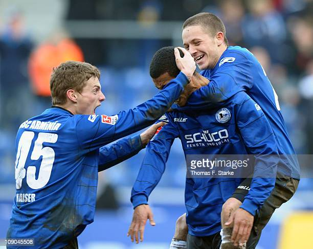 Sandro Kaiser, Marcel Appiah and Alon Abelski of Bielefeld celebrate their teams second goal during the Second Bundesliga match between Arminia...