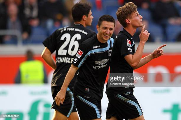 Sandro Kaiser of Muenchen celebrates the second goal with Antonio Rukavina during the Second Bundesliga match between MSV Duisburg and TSV 1860...