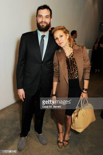 Sandro Kopp and Noomi Rapace attend the Bottletop/Full Circle 2013 Summer Party at Victoria Miro Gallery on June 7 2013 in London England