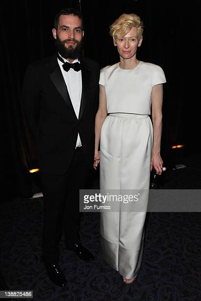 Sandro Kopp and Tilda Swinton attend the Orange British Academy Film Awards 2012 after party at Grosvenor House on February 12 2012 in London England
