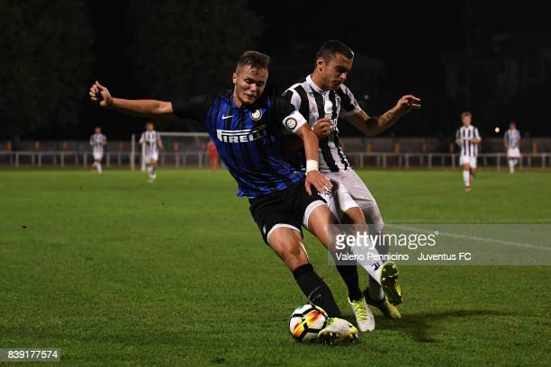 Sandro kulenovic of Juventus U19 competes with Zinho Vanheusden of FC Internazionale U19 during the Torneo Primavera Mamma Cairo match between...