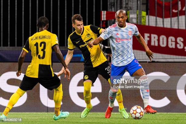 Sandro Lauper of Young Boys fights for the ball with Anthony Martial of Manchester United during the UEFA Champions League group F match between BSC...