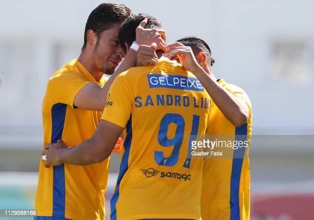 Sandro Lima of GD Estoril Praia celebrates with teammates after scoring a goal during the Ledman Liga Pro match between GD Estoril Praia and Vitoria...