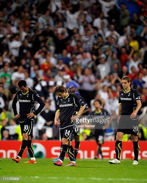 Sandro Luka Modric and Michael Dawson of Tottenham Hotspur look dejected after Cristiano Ronaldo of Real Madrid scored his team's fourth goal during...