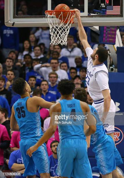 Sandro Mamukelashvili of the Seton Hall Pirates dunks as Grayson Carter Jagan Mosely and Greg Malinowski of the Georgetown Hoyas defend during the...