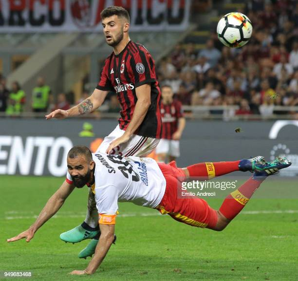 Sandro of Benevento Calcio is challenged by Patrick Cutrone of AC Milan during the serie A match between AC Milan and Benevento Calcio at Stadio...
