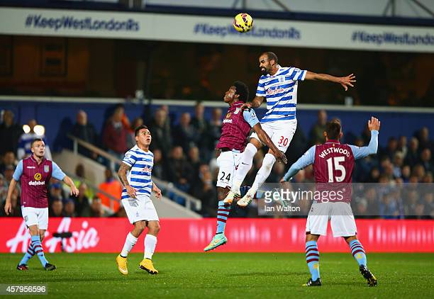 Sandro of QPR climbs above Carlos Sanchez of Aston Villa to head the ball during the Barclays Premier League match between Queens Park Rangers and...