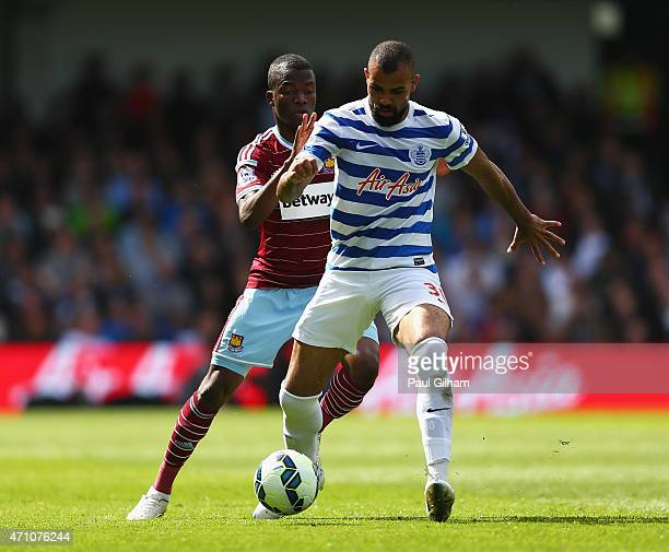 Sandro of QPR holds off Enner Valencia of West Ham during the Barclays Premier League match between Queens Park Rangers and West Ham United at Loftus...
