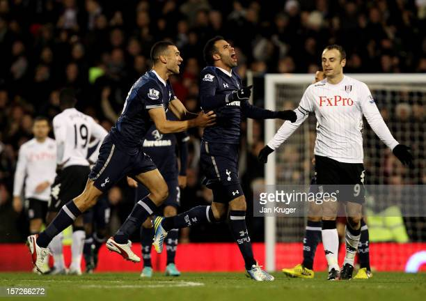 Sandro of Tottenham celebrates his goal with team mate Steven Caulker during the Barclays Premier League match between Fulham and Tottenham Hotspur...