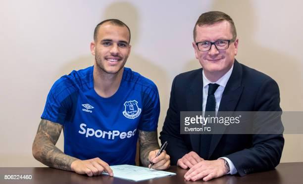Sandro Ramirez looks on as he signs for Everton alongside club secretary David Harrison at Radisson Blu Hotel on June 21 2017 in Gdynia Poland