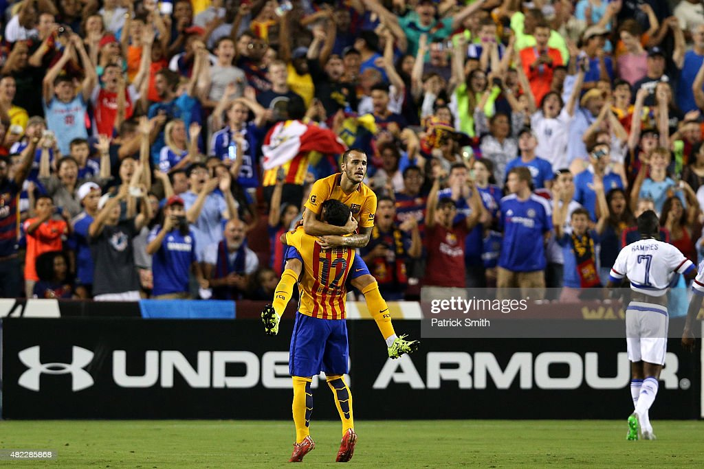 Sandro Ramirez #19 of Barcelona celebrates a goal with teammate Rafinha #12 against Chelsea in the second half during the International Champions Cup North America at FedExField on July 28, 2015 in Landover, Maryland. Chelsea won in a penalty shootout.