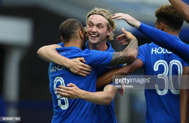 Sandro Ramirez of Everton celebrates with Tom Davies after scoring the opening goal during a preseason friendly match between Everton and Sevilla at...