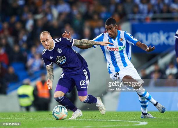 Sandro Ramirez of Real Valladolid CF duels for the ball with Alexander Isak of Real Sociedad during the Liga match between Real Sociedad and Real...