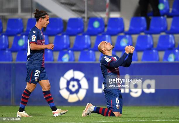 Sandro Ramirez of SD Huesca celebrates with Jaime Seoane after scoring their side's first goal during the La Liga Santander match between SD Huesca...