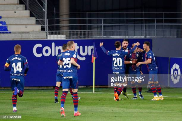 Sandro Ramirez of SD Huesca celebrates with teammates after scoring their team's second goal during the La Liga Santander match between SD Huesca and...