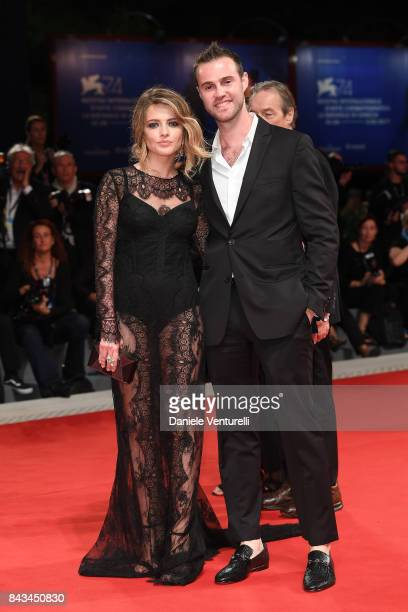 Sandro Rubini and guest walk the red carpet ahead of the 'Loving Pablo' screening during the 74th Venice Film Festival at Sala Grande on September 6...