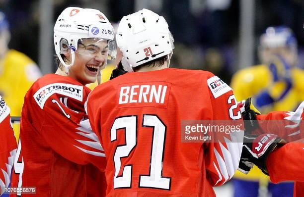 Sandro Schmid and Tim Berni of Switzerland celebrate following a 2-0 win over Sweden following a quarter-final game at the IIHF World Junior...