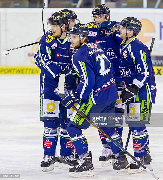Sandro Schoenberger, Peter Flache and Dylan Yeo of the Straubing Tigers celebrate after scoring the 4:1 during the game between Straubing Tigers and...