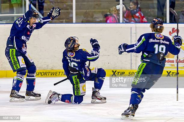 Sandro Schoenberger, Rene Kramer and Harrison Reed of the Straubing Tigers celebrate after scoring the 1:0 during the game between Straubing Tigers...