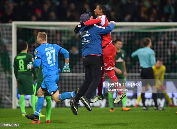 Sandro Schwarz head coach of Mainz celebrates his teams second goal with Abdou Diallo during the Bundesliga match between SV Werder Bremen and 1 FSV...