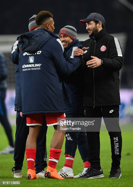 Sandro Schwarz head coach of Mainz celebrates with JeanPhilippe Gbamin of Mainz after the Bundesliga match between Hertha BSC and 1 FSV Mainz 05 at...