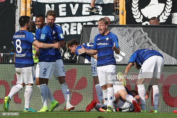 Sandro Sirigu of Darmstadt celebrates his team's first goal with team mates during the Bundesliga match between SV Darmstadt 98 and Eintracht...