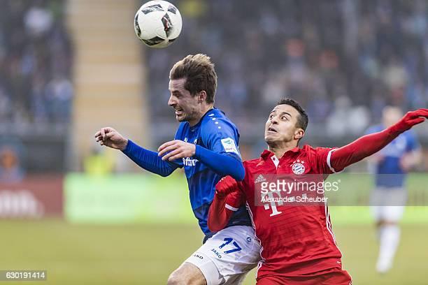 Sandro Sirigu of Darmstadt challenges Thiago of Bayern Muenchen during to the Bundesliga match between SV Darmstadt 98 and Bayern Muenchen at Stadion...