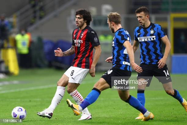 Sandro Tonali of AC Milan is challenged by Christian Eriksen of FC Internazionale during the Serie A match between FC Internazionale and AC Milan at...