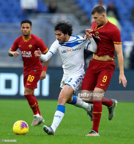 Sandro Tonali of Brescia and Edin Dzeko of Roma during the Serie A match AS Roma v Brescia Fc at the Olimpico Stadium in Rome Italy on November 24...