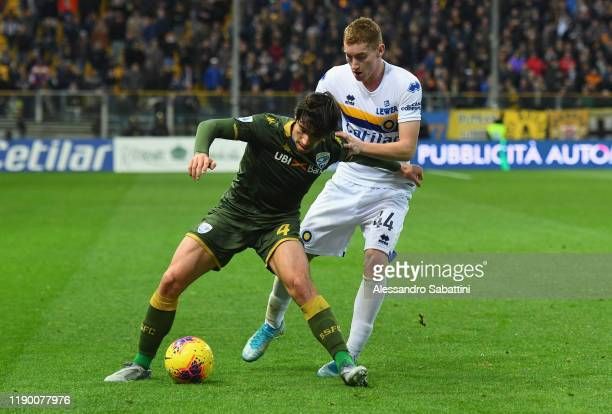 Sandro Tonali of Brescia Calcio competes for the ball with Dejan Kulusevski of Parma Calcio during the Serie A match between Parma Calcio and Brescia...