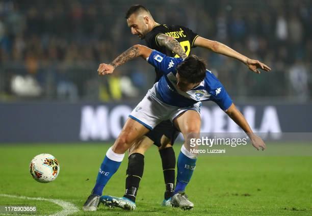 Sandro Tonali of Brescia Calcio competes for the ball with Marcelo Brozovic of FC Internazionale during the Serie A match between Brescia Calcio and...