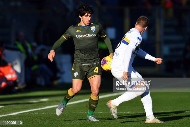 Sandro Tonali of Brescia Calcio competes for the ball with Riccardo Gagliolo of Parma Calcio during the Serie A match between Parma Calcio and...