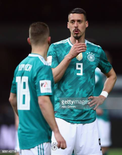 Sandro Wagner and Joshua Kimmich of Germany react during the international friendly match between Germany and Brazil at Olympiastadion on March 27...
