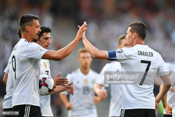 Sandro Wagner and Julian Draxler of Germany celebrate the first goal for their team during the FIFA 2018 World Cup Qualifier between Germany and San...