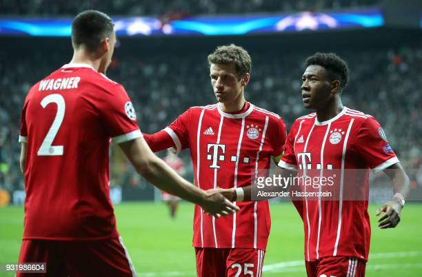 Sandro Wagner of Bayern Muenchen celebrates as he scores their third goal with Thomas Mueller and David Alaba during the UEFA Champions League Round...