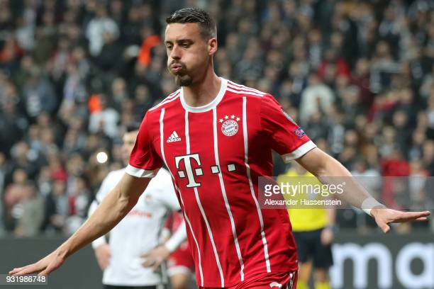 Sandro Wagner of Bayern Muenchen celebrates as he scores their third goal during the UEFA Champions League Round of 16 Second Leg match Besiktas and...