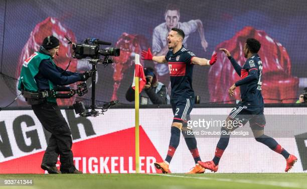 Sandro Wagner of Bayern Muenchen celebrates with team mates after scoring his team's first goal during the Bundesliga match between RB Leipzig and FC...